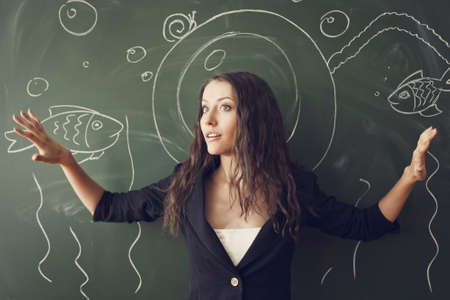 girl over chalkboard with funny painted  diver costume photo