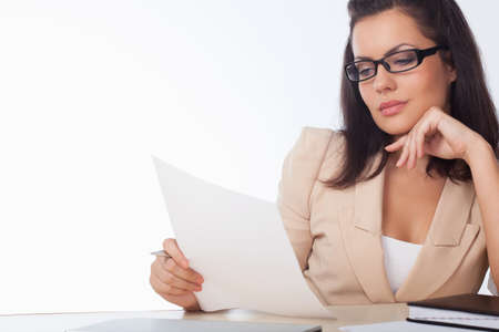 businesswoman reading document over white background photo