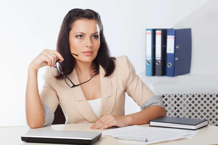 businesswoman sitting at wrokplace and tinking