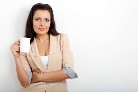 brunette businesswoman holding cup of drink over white Standard-Bild