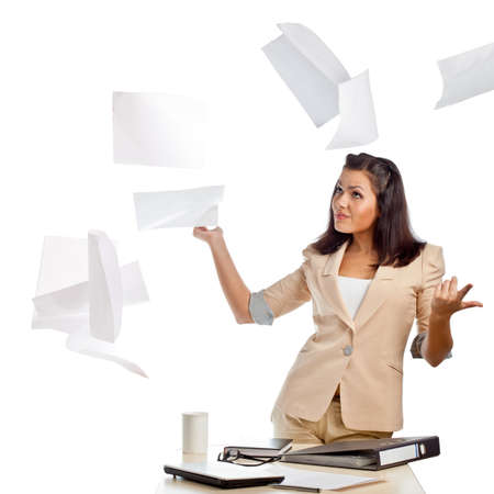 brunette businesswoman throwing up papers in the air