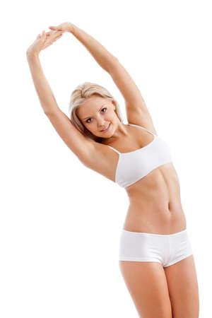 slender woman: slender woman wearing white underwear rising up her hands