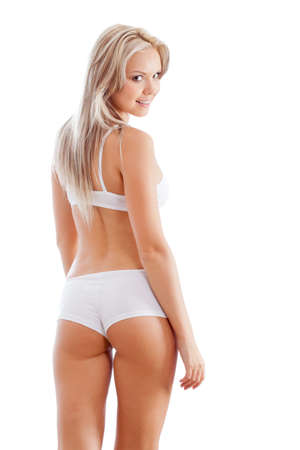 is slender: slender woman wearing white underwear looking back Stock Photo