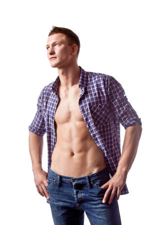 unbuttoned: sexy handsome man posing in casual jeans and unbuttoned shirt, looking up Stock Photo