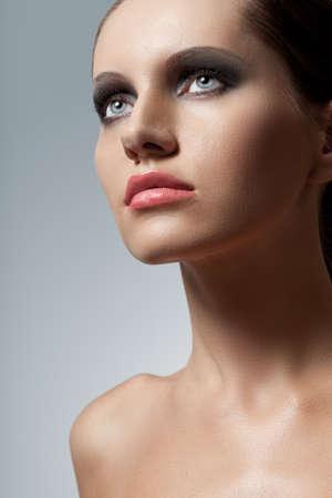 smokey: blue eyed woman face closeup portrait with smoky eyes makeup
