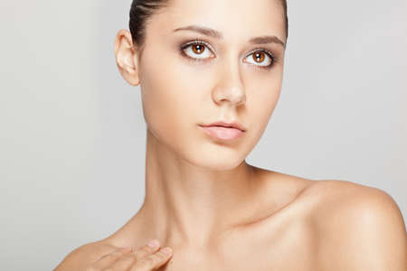 beautiful woman close-up portrait with clear shiny skin