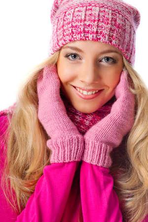 happy beautiful blonde woman wearing pink knitwear over white photo
