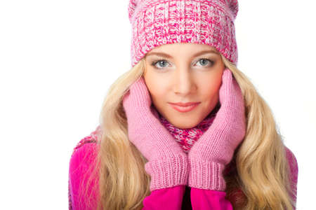 beautiful blonde woman wearing knitwear over white background photo