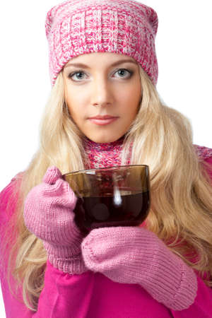 lovely blonde woman holding cup of drink and looking at camera photo
