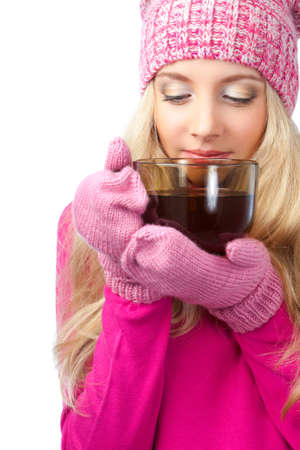 sweater girl: beautiful blonde woman holding cup of drink over white