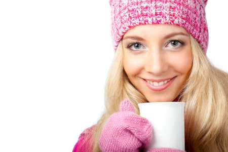 sweater girl: beautiful blonde woman holding white cup of drink