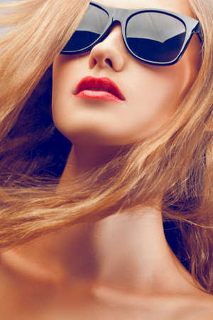 closeup fashion beautiful woman portrait with long hair wearing sunglasses photo