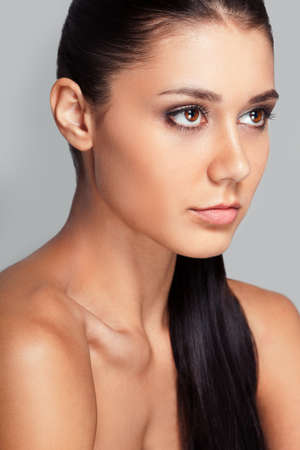 clavicle: beautiful woman close-up portrait with clear skin, looking to the side
