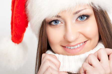 happy smiling  brunette woman portrait wearing santa hat photo