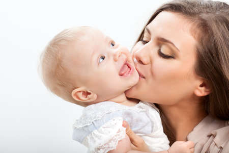 happy mother and baby girl closeup portrait photo