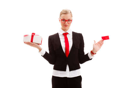 blonde woman holding blank businesscard and giftbox over white background photo