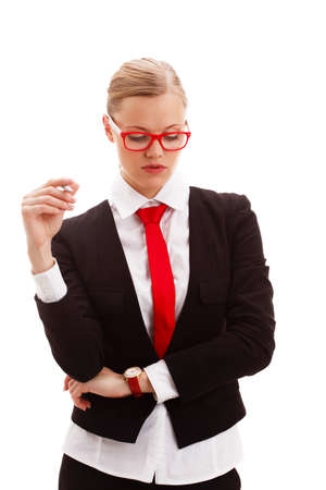 seriously: seriously businesswoman holding pen and looking down over white background Stock Photo