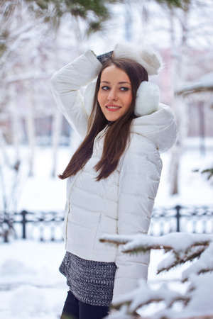 beautiful brunette woman standing in winter park photo