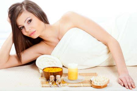 sensual massage: happy beautiful woman wearing towel in spa salon Stock Photo