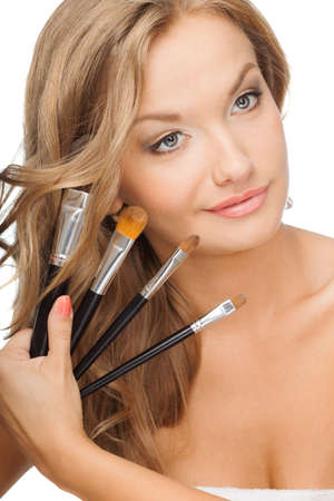 blonde woman holding set of cosmetic brushes Stock Photo - 17608405