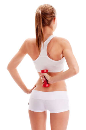 grinning: woman lifting red dumbbells over white, back viewpoint Stock Photo