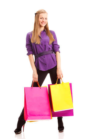 happy blonde woman with shopping bags over white Stock Photo - 17606838