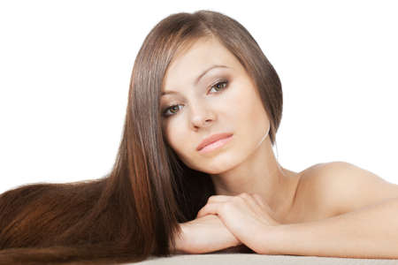 woman portrait with long shiny laying hair on horizontal surface photo