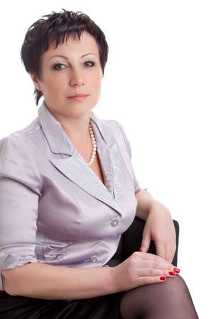 closeup portrait of adult businesswoman sitting on chair over white background photo