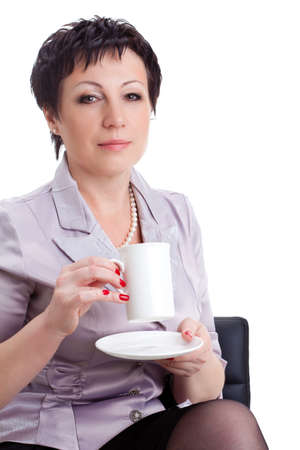 seriously: closeup portrait of adult businesswoman sitting on chair and holding cup over white background