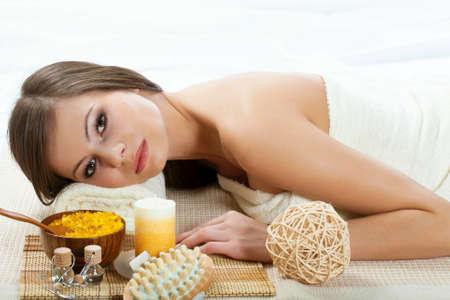 beautiful woman getting treatment in spa salon photo