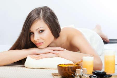 beautiful brunette woman relaxing  in spa salon photo