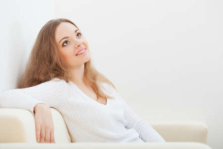 brunette  woman sitting on the sofa at room Stock Photo - 17788122
