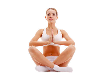 beautiful woman practicing yoga in lotus pose isolated over white photo