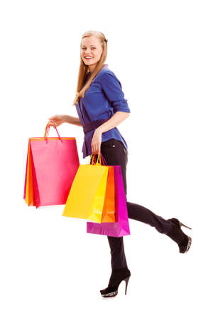 isolated happy smiling  blonde woman carrying shopping bags Stock Photo - 18201015