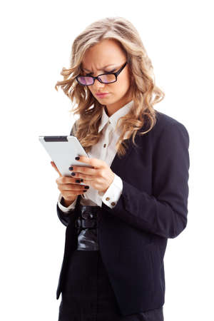 hair tied: thoughtful businesswoman working with tablet over white