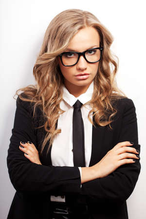 seriously: closeup seriously blonde businesswoman portrait wearing eyeglasses