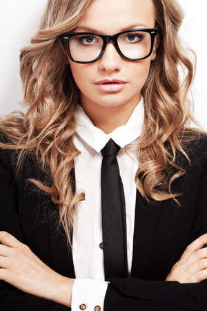 wearing glasses: closeup seriously blonde businesswoman portrait wearing eyeglasses