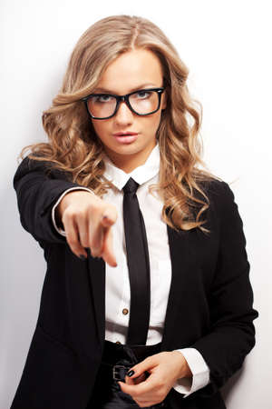 seriously: closeup seriously businesswoman portrait wearing eyeglasses showing forward with finger