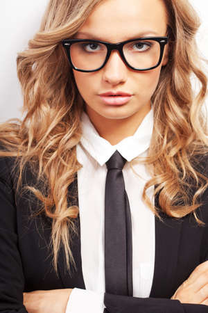 closeup seriously businesswoman wearing eyeglasses portrait photo
