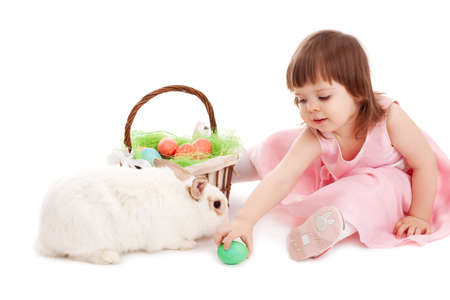 little girl playing with fur eatser rabbit over white photo