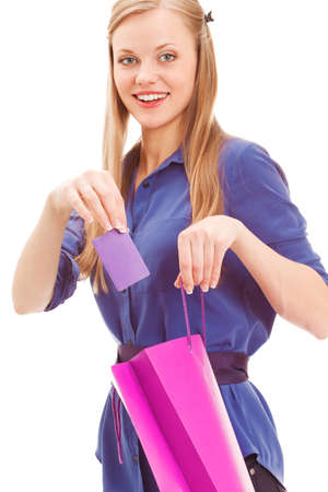 blond woman put in card into bag over white background Stock Photo - 18387409