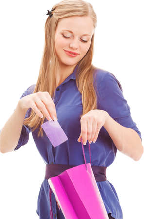 put: smiling blond woman put in card into bag over white backround