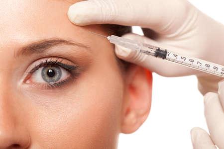 closeup schöne Frau Auge, Spritzeninjektion Beauty-Konzept Lizenzfreie Bilder