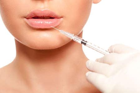 closeup schöne Frau Gesicht, Spritze Injektion Lippen Beauty-Konzept