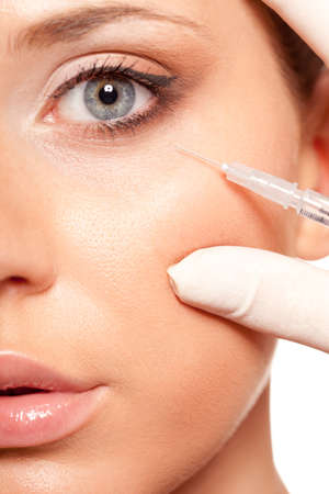 closeup beautiful woman face, syringe injection beauty concept Stock Photo - 18387379