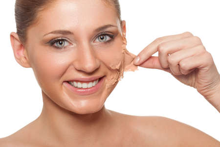 removing: smiling brunette woman taking off her skin from face over white
