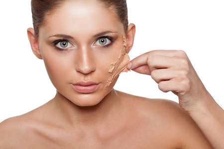 brunette woman taking off her skin from face over white photo