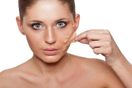 splitting up: brunette woman taking off her skin from face over white