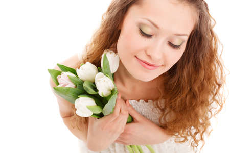 long haired: happy beautifu long haired smiling woman holding tulips, top point of view Stock Photo