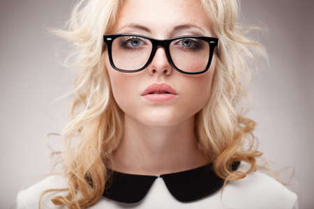 closeup horizontal portrait of blonde young beautifulwoman wearing eyeglasses photo